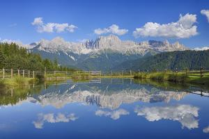 Rosengarten Mountains Reflecting in Small Lake. by Martin Ruegner