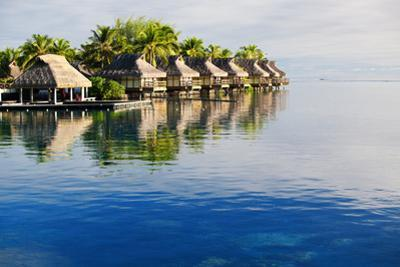 Amazing Tropical Resort with Huts over Water by Martin Valigursky