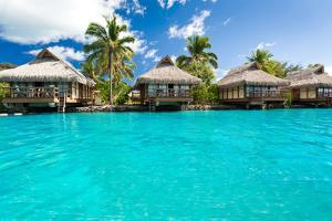 Over Water Bungalows with Steps into Amazing Blue Lagoon by Martin Valigursky