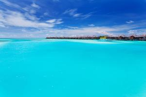 Overwater Villas in Tropical Blue Laggon of Maldives by Martin Valigursky