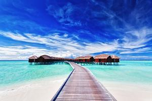 Overwater Villas on the Tropical Lagoon by Martin Valigursky