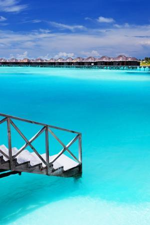 Steps into Amazing Blue Lagoon with Over-Water Bungalows by Martin Valigursky
