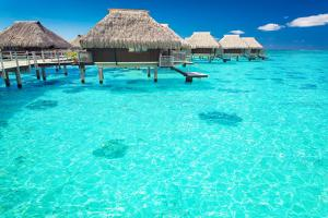 Water Villas in the Ocean with Steps into Turquoise Lagoon by Martin Valigursky
