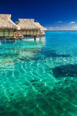 Water Villas over Tropical Coral Reef by Martin Valigursky