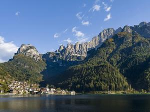 Alleghe at Lago di Alleghe under the peak of Civetta, an icon of the dolomites in the Veneto. by Martin Zwick