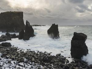 Coast near Reykjanesviti and Valahnukur on Reykjanes peninsula during winter. by Martin Zwick