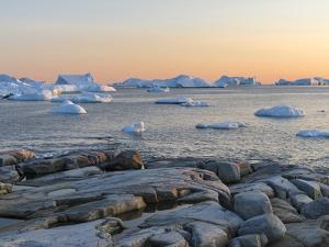 Coastal landscape with Icebergs. Inuit village Oqaatsut located in Disko Bay. Greenland by Martin Zwick