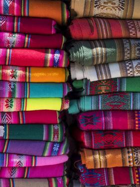 Colorful scarfs or blankets for tourists. Town of Humahuaca in the Quebrada de Humahuaca canyon by Martin Zwick