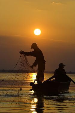 Fishing in the Danube Delta, Casting Nets During Sunset on a Lake, Romania by Martin Zwick