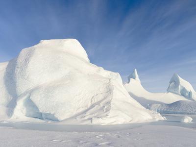 Iceberg frozen into the sea ice of the Melville Bay, near Kullorsuaq in the far north
