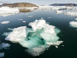 Icebergs in the Uummannaq fjord system, northwest Greenland, Denmark. by Martin Zwick