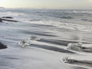 Icebergs on black volcanic beach, Iceland. by Martin Zwick