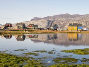 Ikerasak, a small traditional fishing village on Ikerasak Island in the Uummannaq fjord system by Martin Zwick