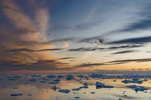 Ilulissat Icefjord also called kangia or Ilulissat Kangerlua, sunset over Disko Bay. Greenland by Martin Zwick