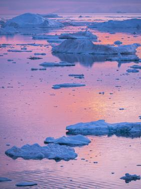 Ilulissat Icefjord also called kangia or Ilulissat Kangerlua, sunset over Disko Bay. by Martin Zwick