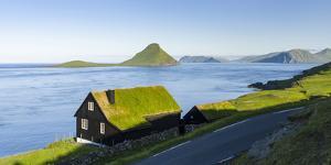 Koltur island at sunrise, village Velbastadur. Denmark, Faroe Islands by Martin Zwick
