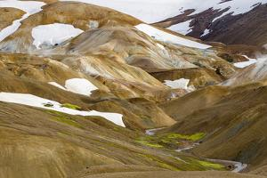 Landscape in the geothermal area Hveradalir in the highlands of Iceland in August. by Martin Zwick