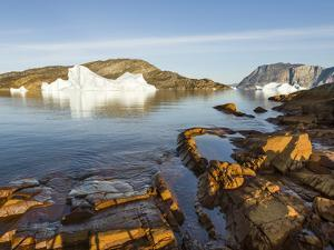 Landscape with icebergs in the Uummannaq fjord system, northwest Greenland, Denmark by Martin Zwick