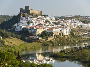 Mertola on the banks of Rio Guadiana in the Alentejo. Portugal by Martin Zwick