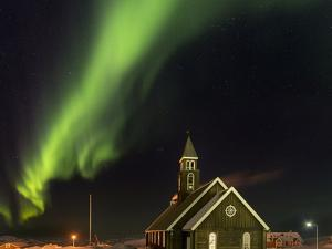 Northern Lights over the Zion's Church. Ilulissat at the shore of Disko Bay, by Martin Zwick