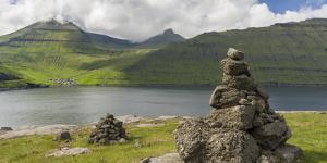 Old traditional cairns and mount Slaettaratindur, Funningsfjordur, Denmark by Martin Zwick