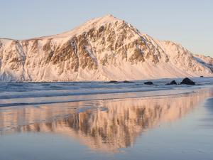 Sunrise over Flakstad and Skagsanden beach. The coast near Flakstad, island Flakstadoya. The Lofote by Martin Zwick