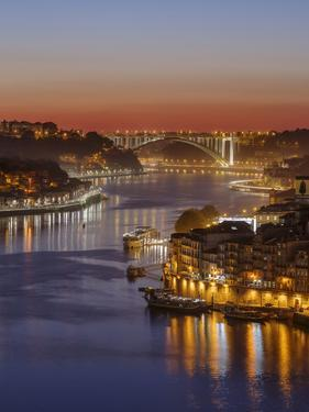 Sunset over Rio Douro. Left Vila Nova de Gaia, right the old town. The old town is listed as UNESCO by Martin Zwick