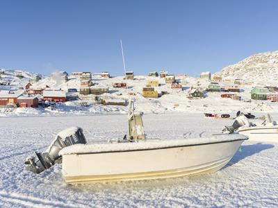 The frozen harbor. The traditional and remote Greenlandic Inuit village Kullorsuaq