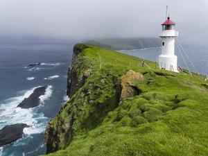 The Lighthouse On Mykinesholmur. Island Mykines, Faroe Islands. Denmark by Martin Zwick