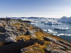 Tourists admiring the fjord. Ilulissat Icefjord also called kangia or Ilulissat Kangerlua by Martin Zwick