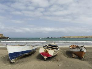 Traditional fishing boats on the beach of Praia Baixo. Santiago Island, Cape Verde. by Martin Zwick