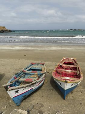 Traditional fishing boats on the beach of Praia Baixo. Santiago Island, Cape Verde by Martin Zwick