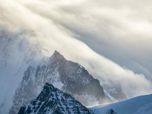 Typical storm clouds over the mountains of the Allardyce Range. by Martin Zwick