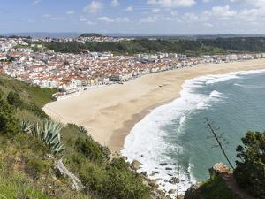 View over town and beach from Sitio. The town Nazare on the coast of the Atlantic Ocean. Portugal by Martin Zwick