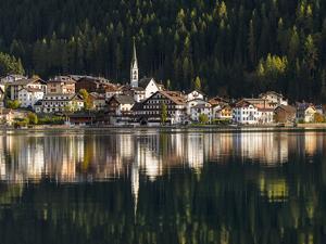 Village Alleghe at Lago di Alleghe at the foot of mount Civetta, Dolomites, Veneto, Italy by Martin Zwick