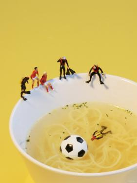 Footballers Looking for Ball in Noodle Soup Pond by Martina Schindler