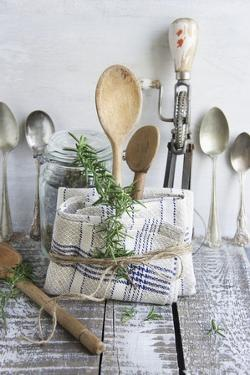 Old Kitchen Utensils: Spoons, Beater, Wooden Spoon and Linen Dish Towel by Martina Schindler