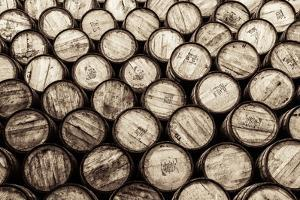 Detail Monochrome View of Stacked Wine and Whisky Wooden Barrels by MartinM303