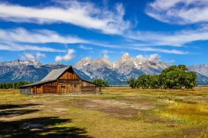 Scenic View of Grand Teton with Old Wooden Farm by MartinM303