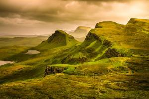 Scenic View of Quiraing Mountains Sunset with Dramatic Sky, Scotland by MartinM303
