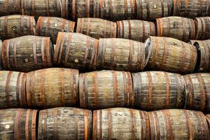 Stacked Pile of Old Whisky and Wine Wooden Barrels by MartinM303