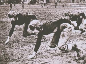 Football Players, Early 1900S by Marvin Boland