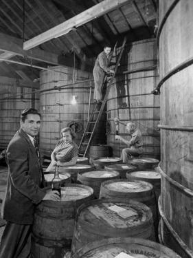 Marvin Sands and His Wife Operating their Own Laboratory for Wine Making