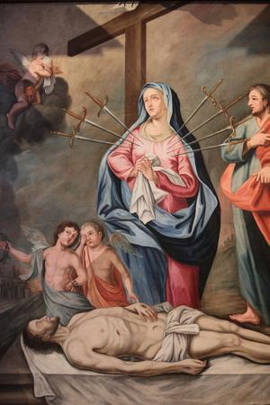 https://imgc.allpostersimages.com/img/posters/mary-s-seven-sorrows-our-lady-of-assumption-church-cordon-france_u-L-Q1GYMMZ0.jpg?artPerspective=n
