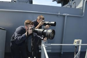 Mass Communication Specialists Take Photos and Video of Surface Contacts