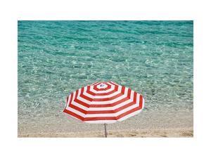Close up of Striped Beach Umbrella near Sea, San Vito Lo Capo, Sicily, Italy by Massimo Borchi