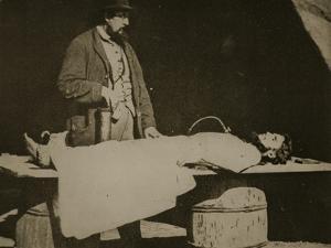 Embalming Surgeon at Work, 1861-65 by Mathew Brady