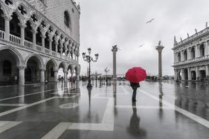 Italy, Veneto, Venice. Woman with Red Umbrella in Front of Doges Palace with Acqua Alta (Mr) by Matteo Colombo