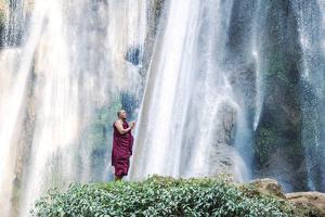 Myanmar, Mandalay Division, Pyin Oo Lwin. Burmese Monk Praying under Dattawgyaik Waterfall (Mr) by Matteo Colombo
