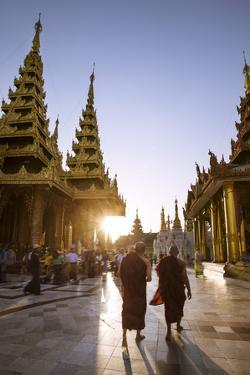 Myanmar, Yangon. Two Buddhist Monks Walking Inside Shwedagon Pagoda Complex at Sunset (Mr) by Matteo Colombo
